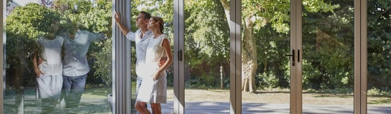 Couple looking out window | Demers Glass - Residential Glass provider in AZ
