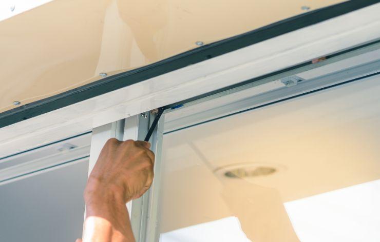 Glazier installing residential window   Demers Glass AZ