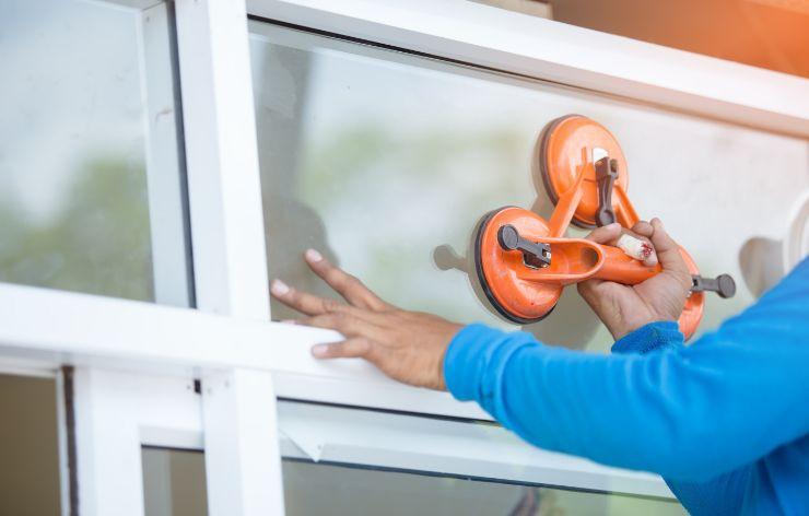 Glazier replacing residential window   Demers Glass AZ