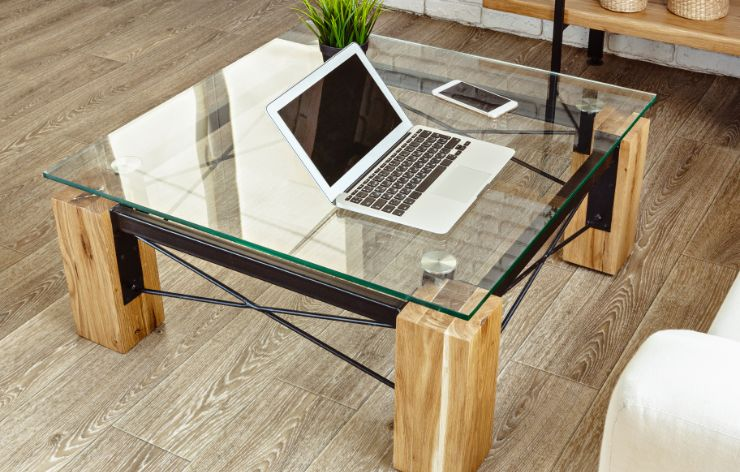 Glass coffee table with laptop and phone sitting on top | Demers Glass AZ