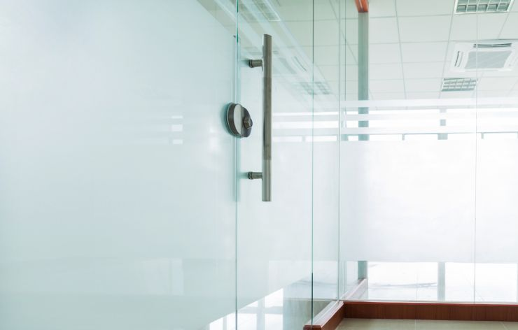 Commercial glass in office with white out film   Demers Glass AZ