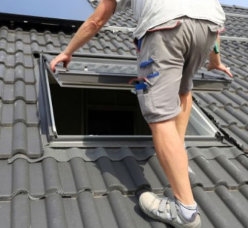 Demers technician installing a skylight