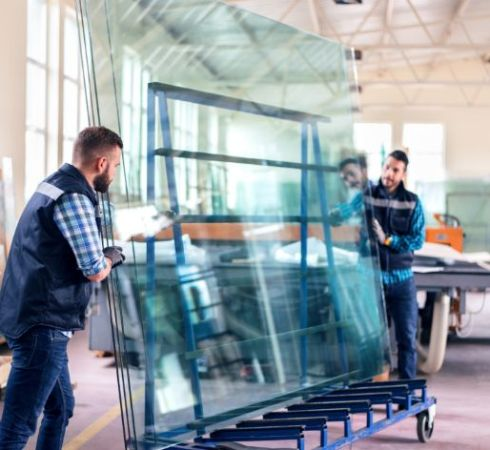 Demers team moving large sheets of glass