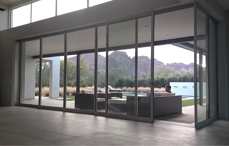 Oversized automated glass doors opening to a backyard | Demers Glass AZ