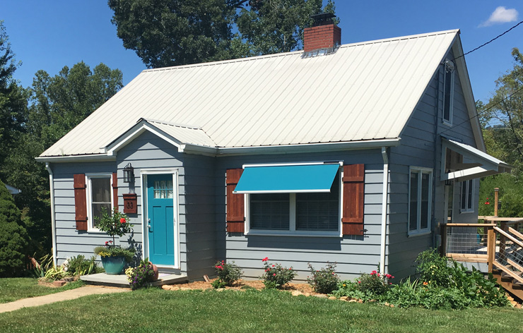 Small house with blue door and outdoor window awning | Demers Glass AZ