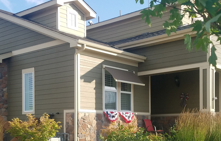 A home with a retractable window awning | Demers Glass AZ