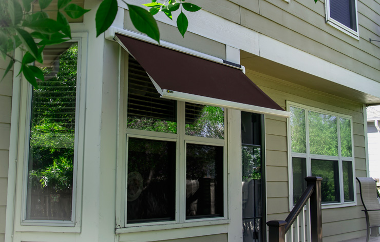 Townhome with a maroon automatic, solar-powered window awning | Demers Glass AZ