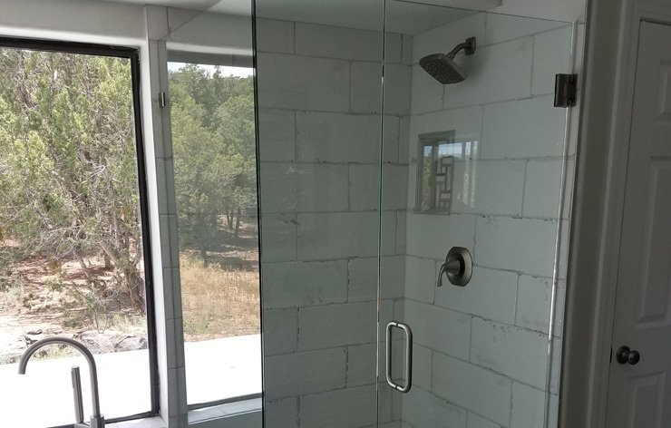 Frameless glass shower enclosure installed in primary bathroom by Demers Glass in AZ