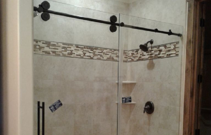 Modern bathroom with new frameless shower enclosure installed by Demers Glass in AZ