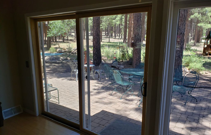Interior view of new sliding glass doors leading to a backyard