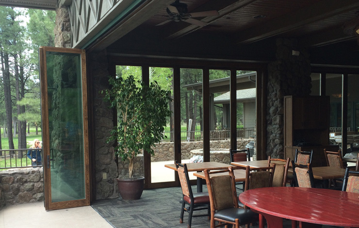 Forest Highlands windows accordion folded opening up to outside patio