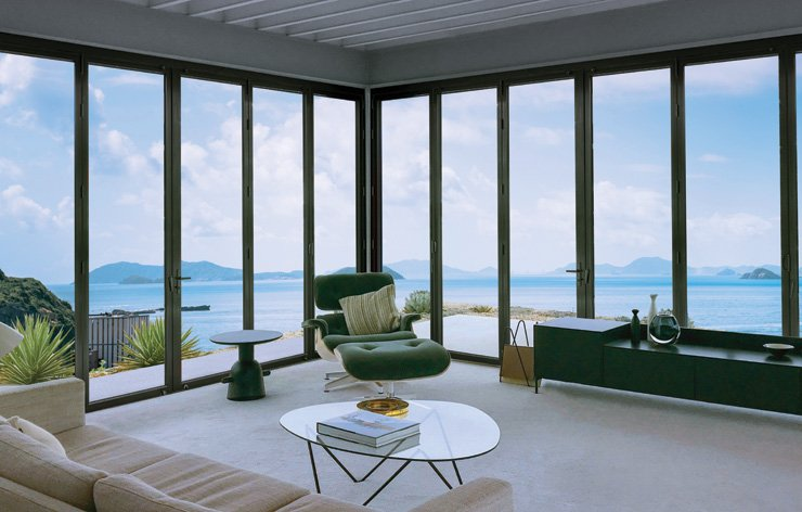 Open living room with large windows and an ocean view by Panda Windows | Demers Glass AZ