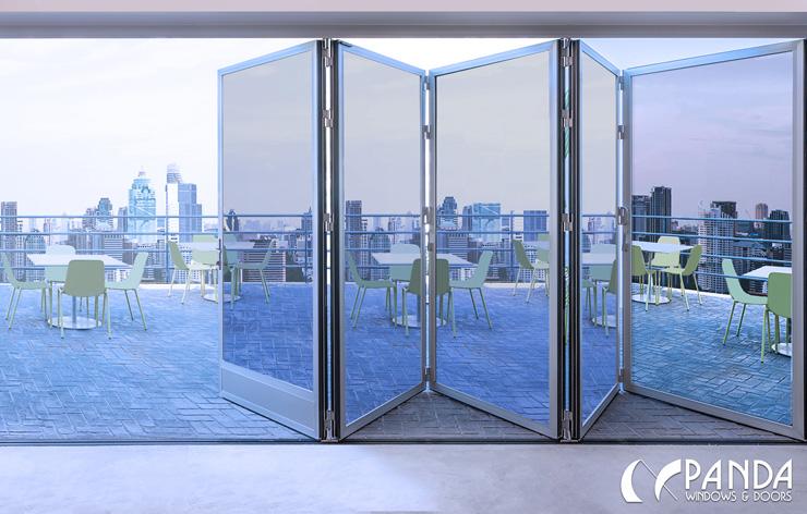 Bi-fold oversized windows opening up to the outside by Panda Windows   Demers Glass AZ