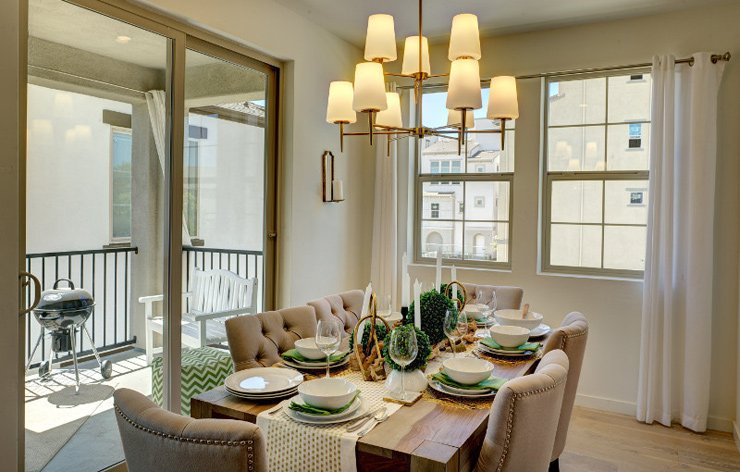 Bright dining room with a set table, sliding glass doors, large windows by Ply Gem, a Demers Glass Partner