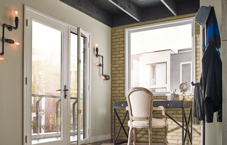 Modern study with large doors and windows for natural light by Ply Gem, a Demers Glass Partner