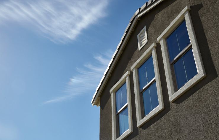 Upward looking view of a residential home with new windows by Ply Gem, a Demers Glass Partner