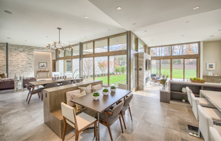 Open kitchen and family room with large oversized windows by Weather Shield, a Demers Glass partner