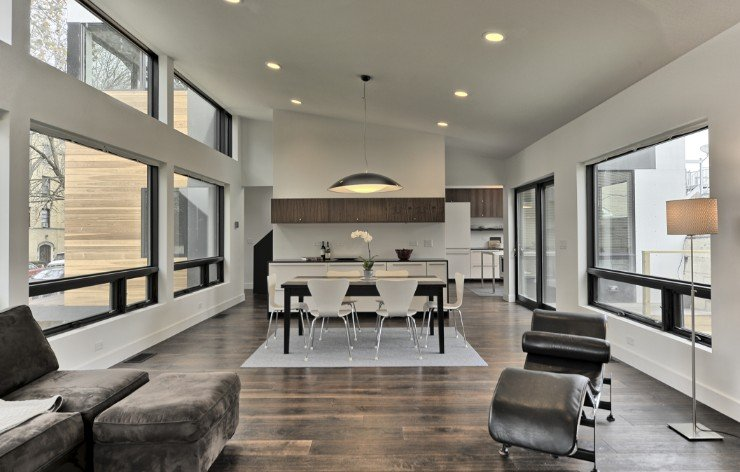 Modern living room with oversized windows by Weather Shield, a Demers Glass partner