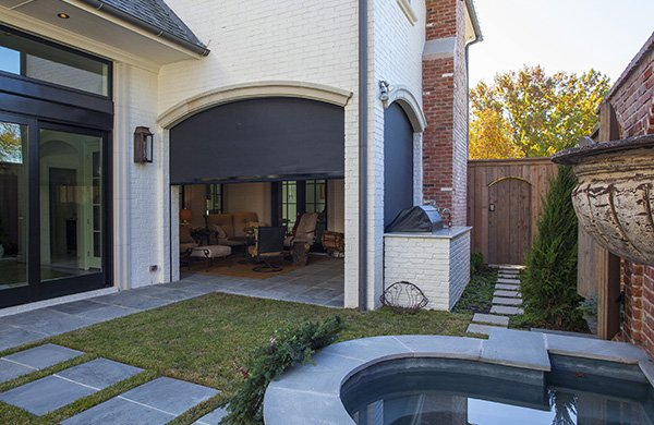 Backyard with Mirage retractable screens opening up to a covered patio