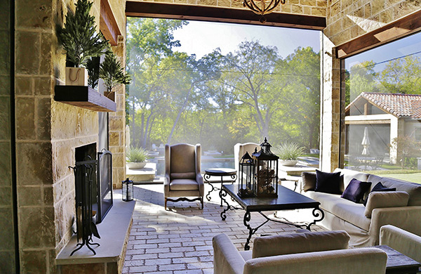 Elegant patio with large retractable screens giving a view to the backyard