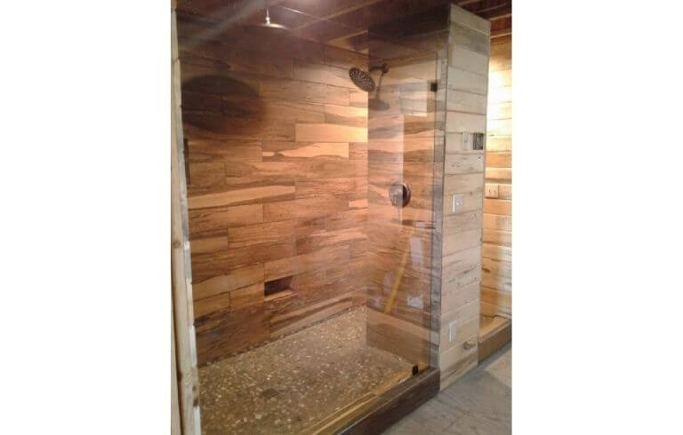 Large walk-in frameless glass shower enclosure with wood paneling | Demers Glass AZ
