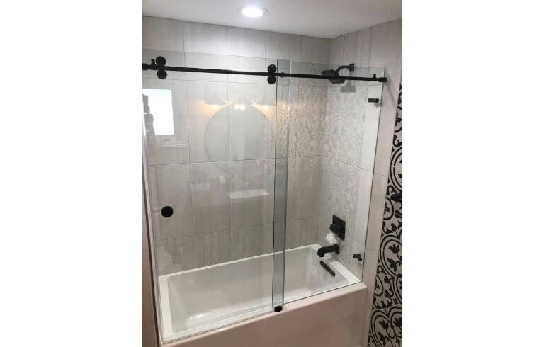 Glass frameless shower enclosure with tub | Demers Glass AZ